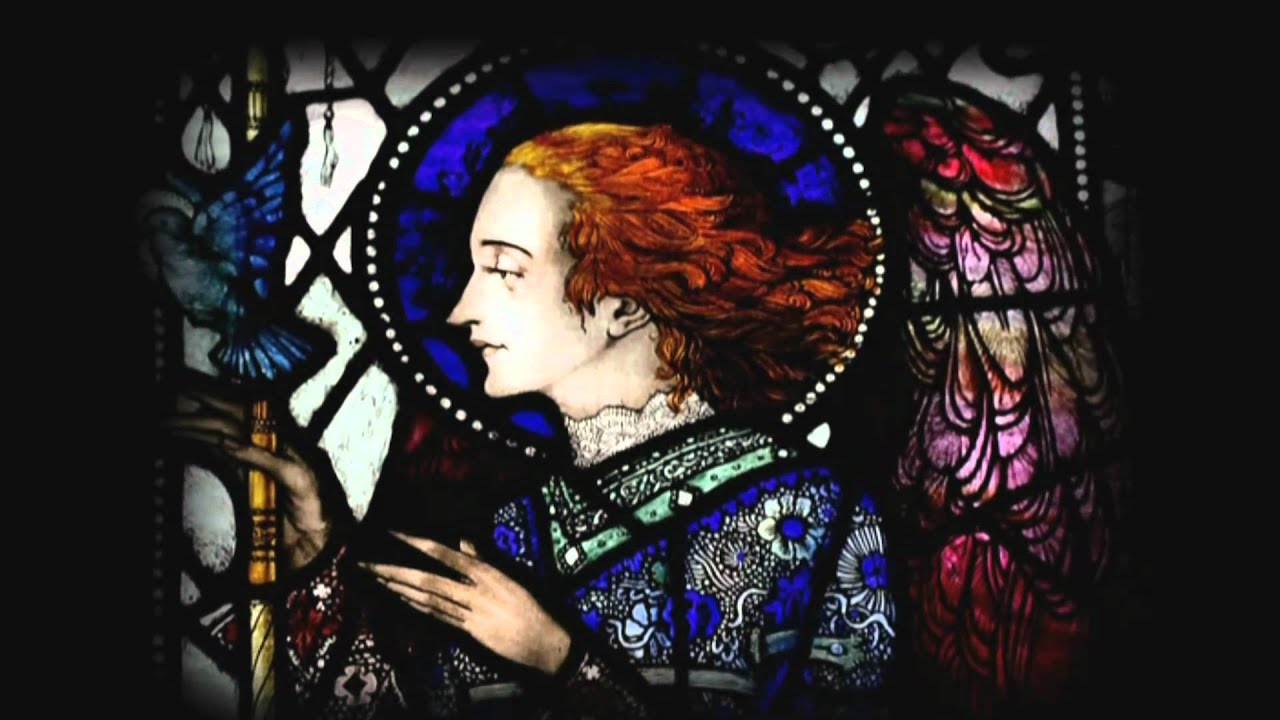 Harry Clarke stained glass window of angel with red hair